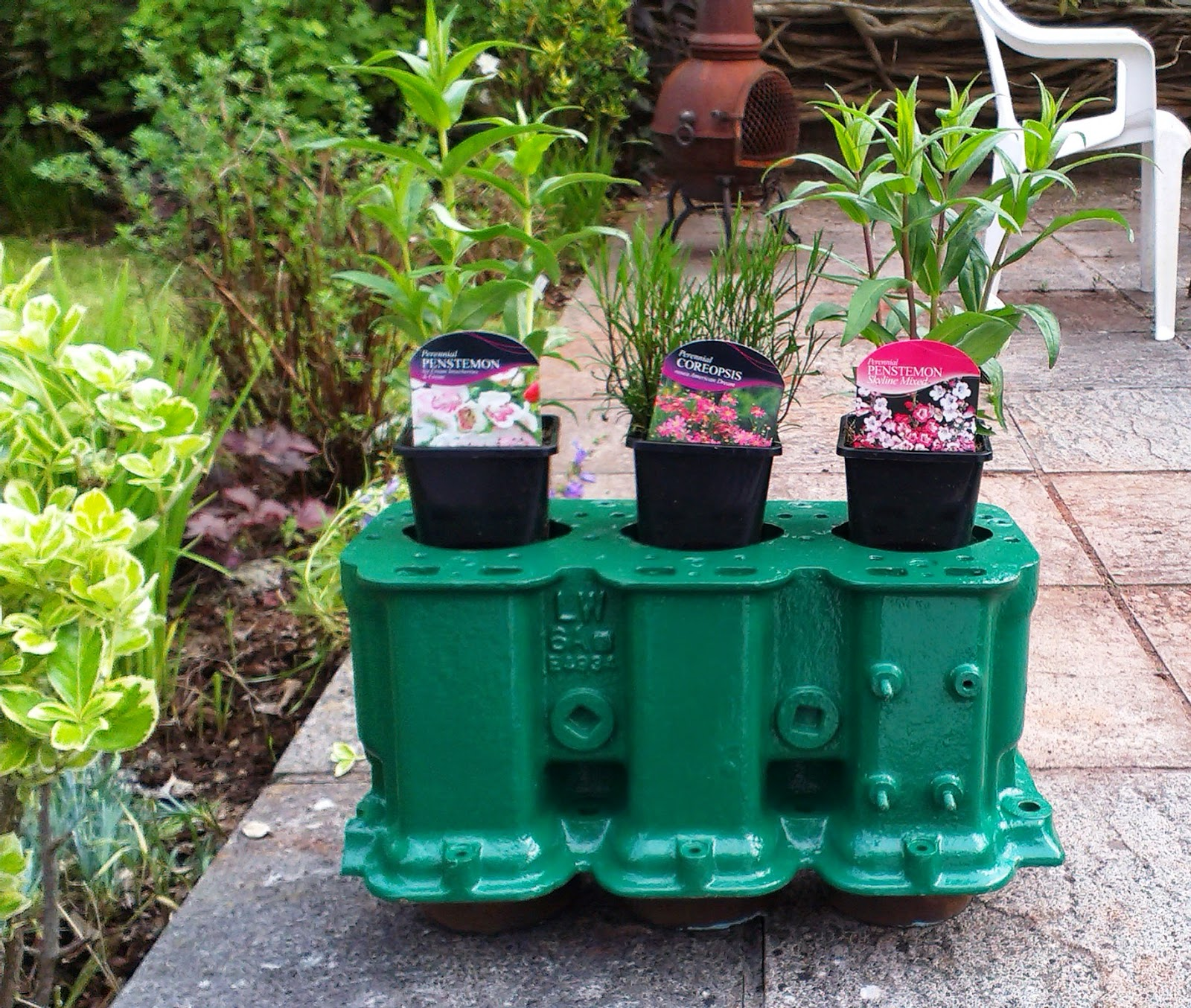 Flowerpots in an old engine block
