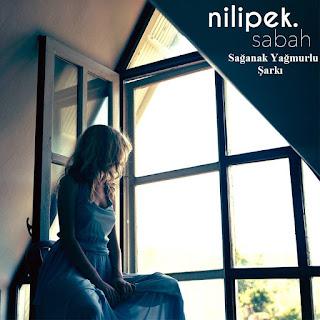 Nilipek - Sağanak Yağmurlu Şarkı Dinle şarkı sözleri