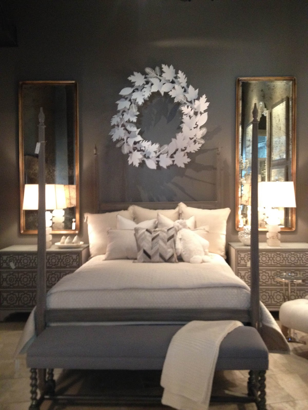 Love the two mirrors directly above the side tables