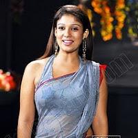 Nayanatara looks very hot in wet saree