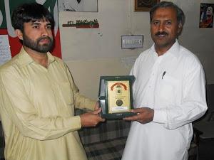 Presenting Shield to Engr:Hamidul Haq MNA