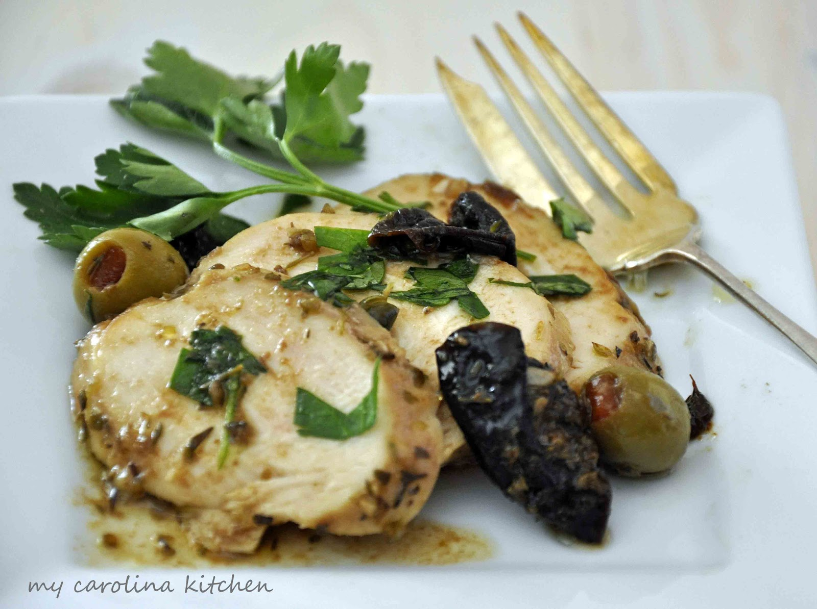 Chicken Marbella recreated into cocktail food for a party buffe t