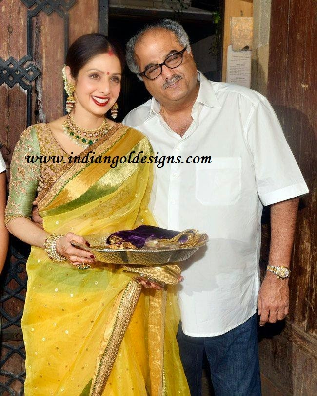 Latest saree designs sridevi in yellow designer saree checkout sridevi in yellow designer saree with shimmer and gold shimmer border and paired with matching embroidery half sleeves designer blouse sridevi altavistaventures Image collections