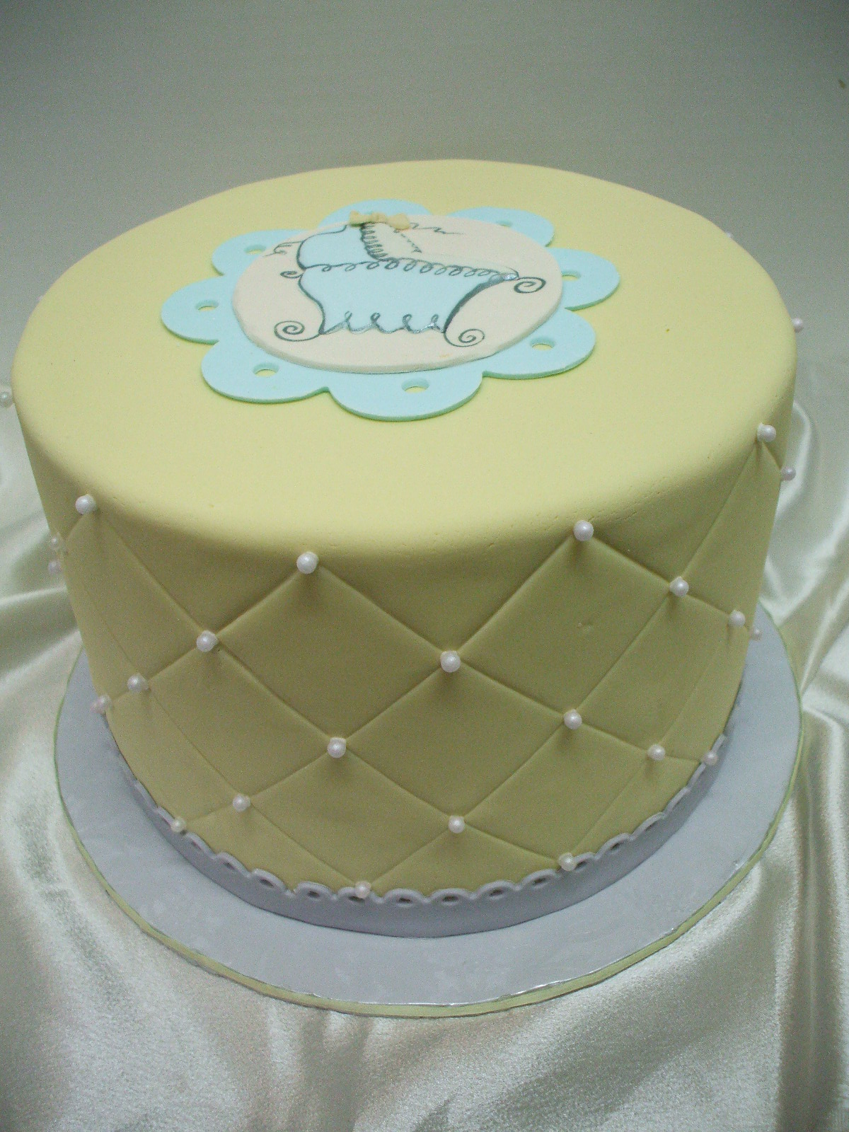 this is such a sweet baby shower cake the soft yellow and gray palette ...