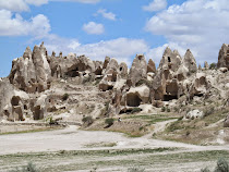 Hobbit warren of pinnacles, caves, homes and churches in Cappadocia -- near Goreme, Turkey