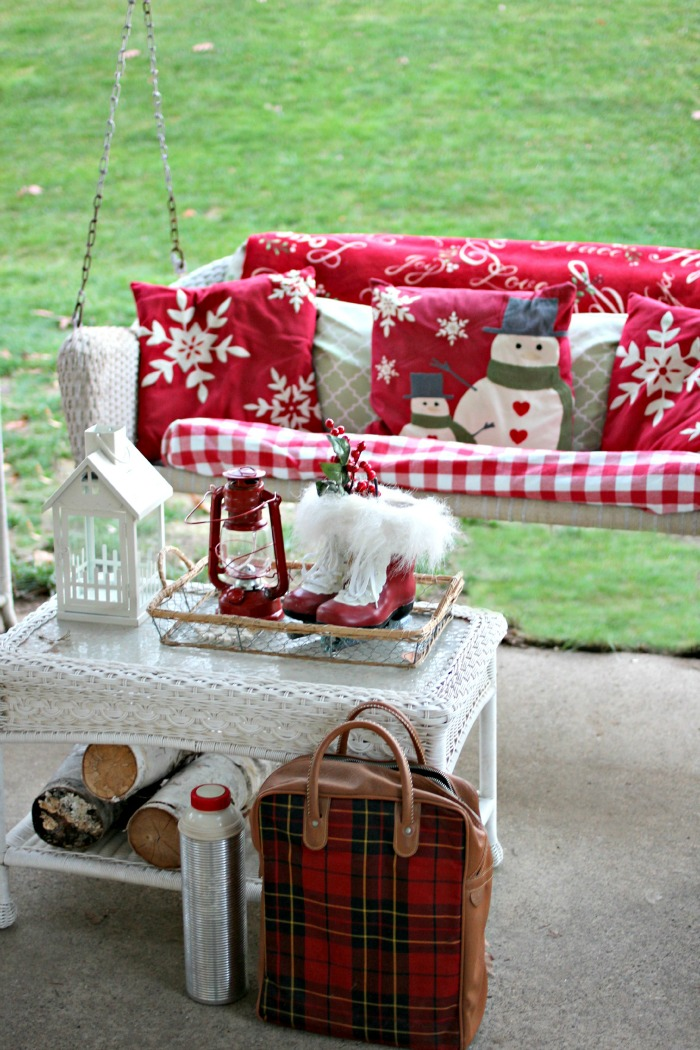 Outdoor covered patio decorated for Christmas with red and white - www.goldenboysandme.com