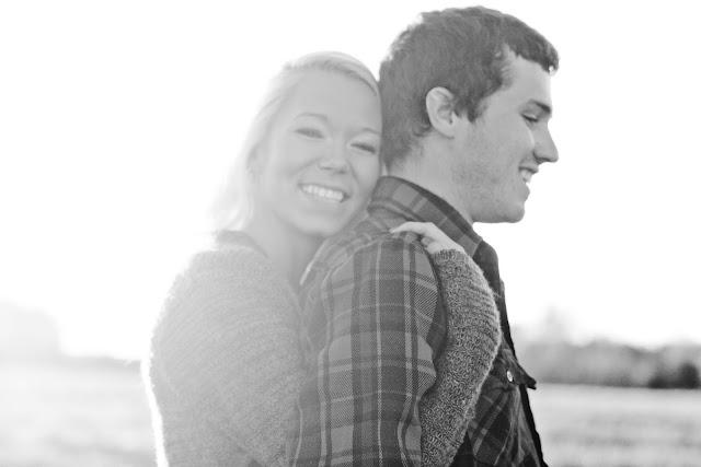 girl with arms wrapped around boyfriend
