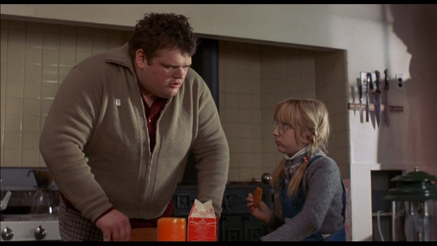 Erland van Lidth shares cookies and milk with Elizabeth Ward in Alone In The Dark (1982)