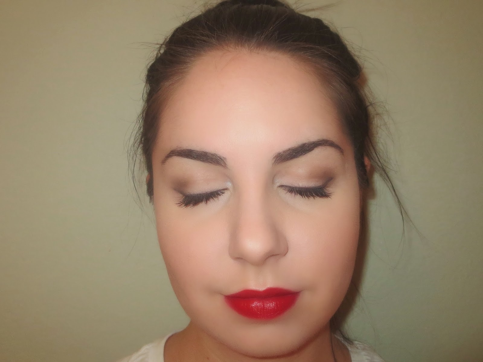 a picture of a classic black liner red lip makeup look