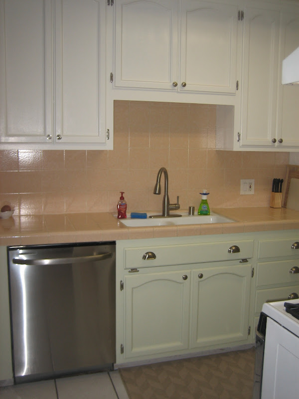 Final After picture with painted kitchen cabinets, new dishwasher and  title=