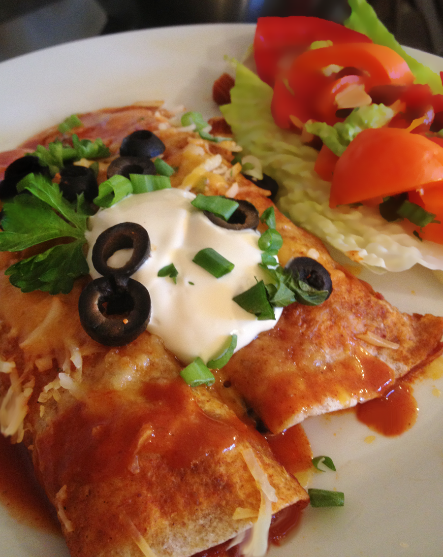 Image of 2 Light & Easy Enchiladas served on a white plate with a side salad