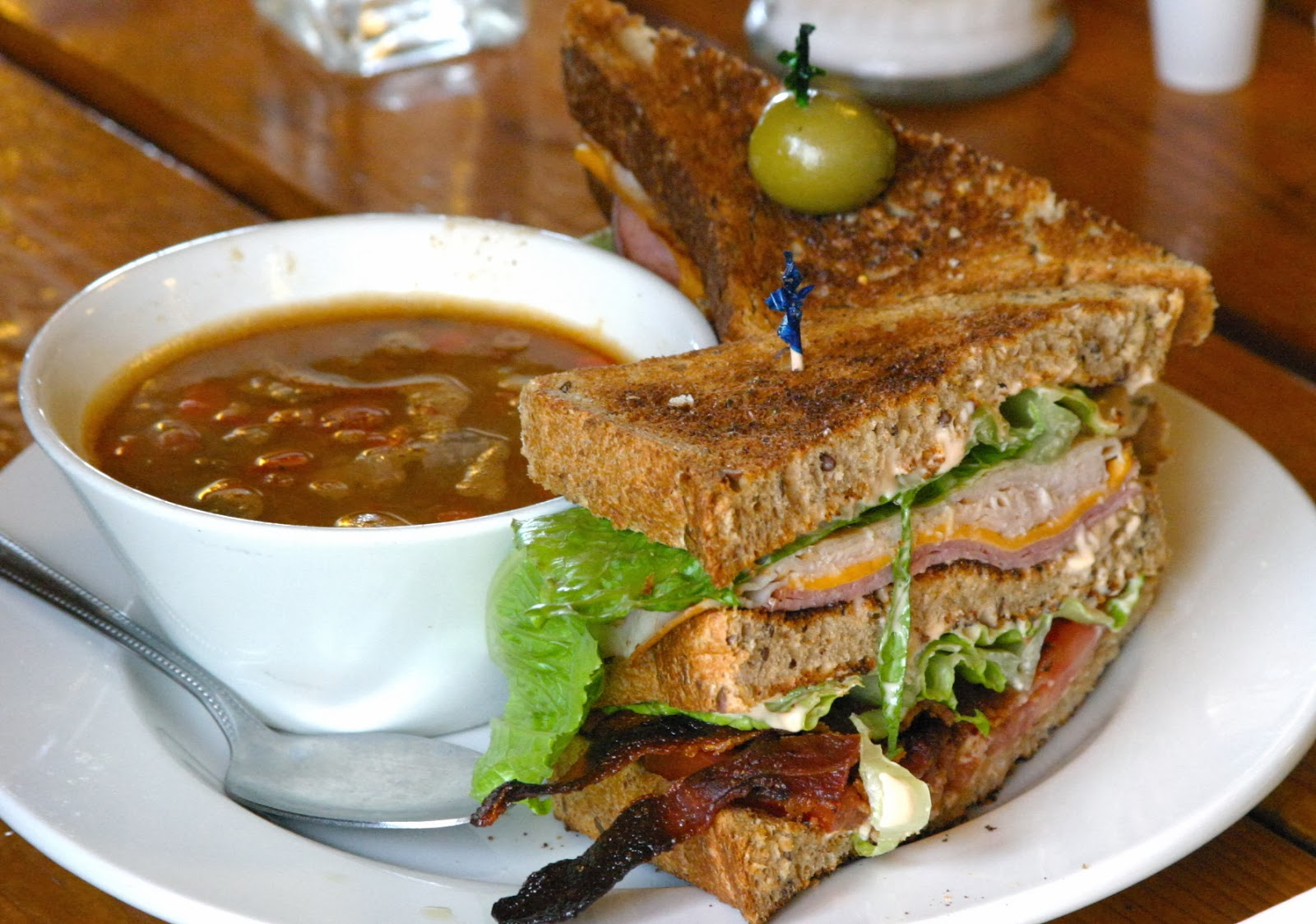hearty beef barley soup with a classic club sandwich