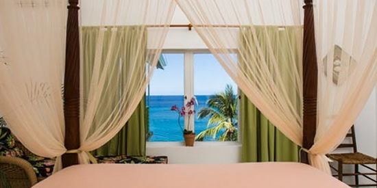 View of the sea through the bedroom