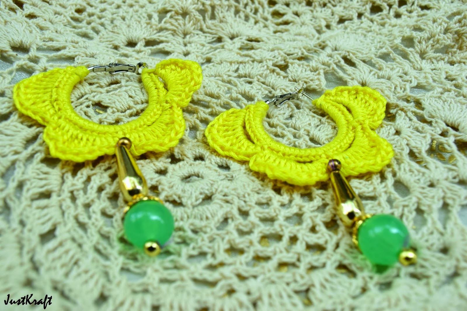 Yellow hoops crochet earrings with a golden and green drop