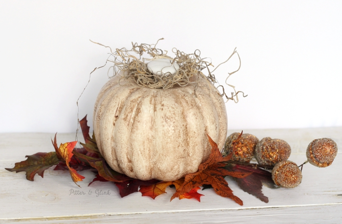 Transform a cheap dollar store pumpkin into a vintage-inpsired shabby pumpkin.  A great piece of rustic fall decor for your mantel! www.pitterandglink.com