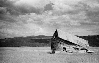 B&W photo of a crumbling barn