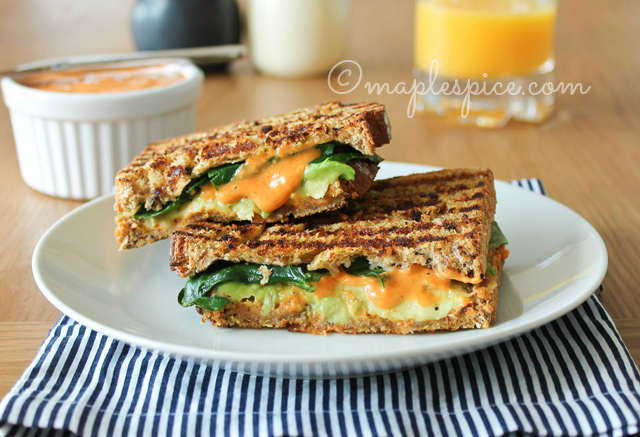 Pan Grilled Avocado, Baby Spinach and Basil Multigrain Sandwich with Roasted Red Pepper Almond Mayo.