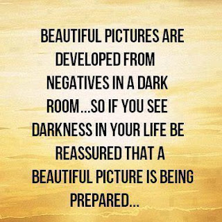 Beautiful pictures are developed from negatives in a dark room...