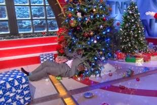 LOL! Shaquille O'Neal Takes a Tumble Head First Into a Christmas Tree