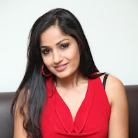 heavenly sweetheart Madhavi latha in red sleeveless tops