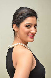 Richa Panai in Beautiful Tight Black Sleevelss Gown and beautiful Pearl Necklace at Memu Audio Release