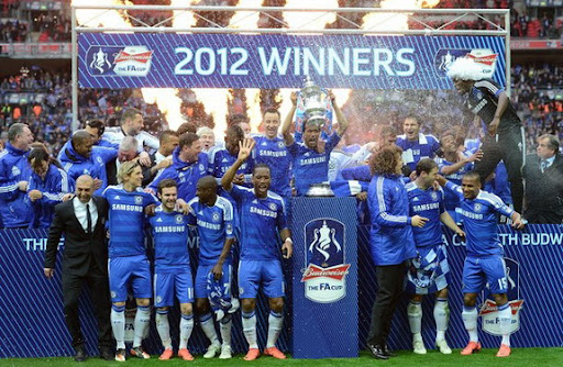 Chelsea players celebrate on the pitch after winning the FA Cup