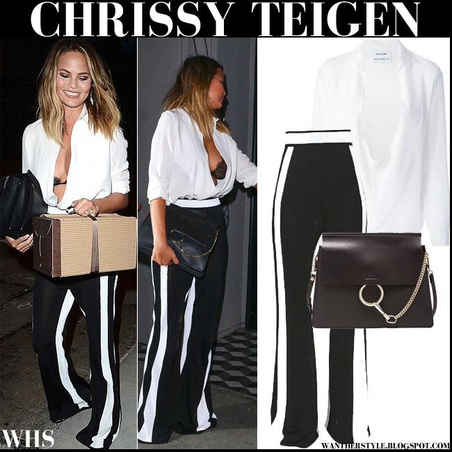 Chrissy Teigen in white plunging Anthony Vaccarello blouse, black lace bra, black white stripe Balmain flared pants with Chloe Faye bag what she wore august 3