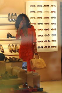 Rihanna in an orange dress at the store