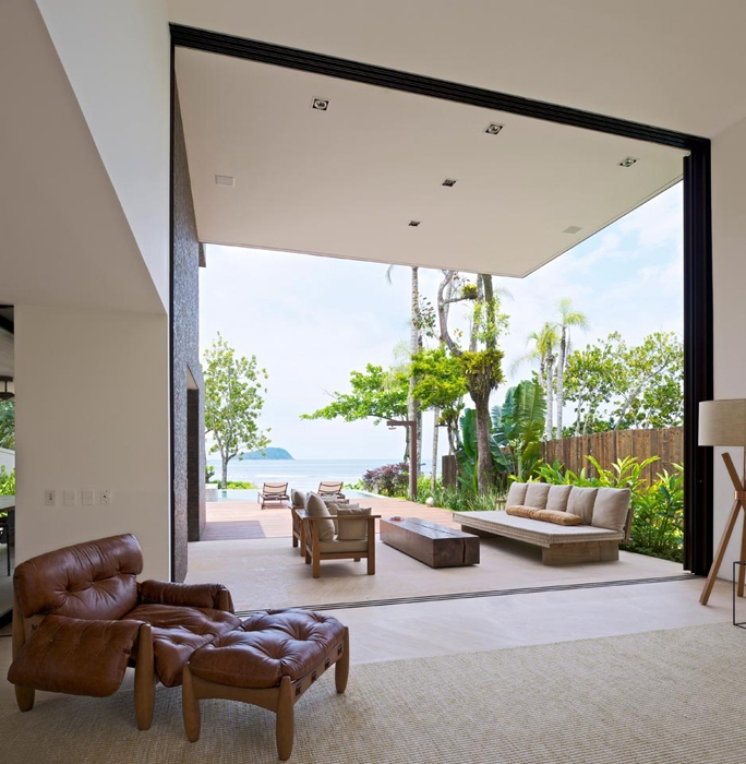 Open glass wall in Modern beach house in Brazil