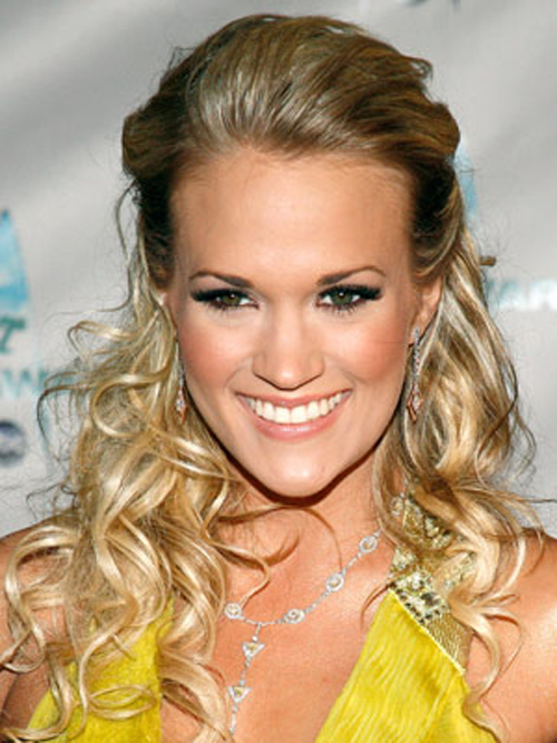 Carrie Underwood's pinned-back curls create a graceful hairstyle for a night on the town.
