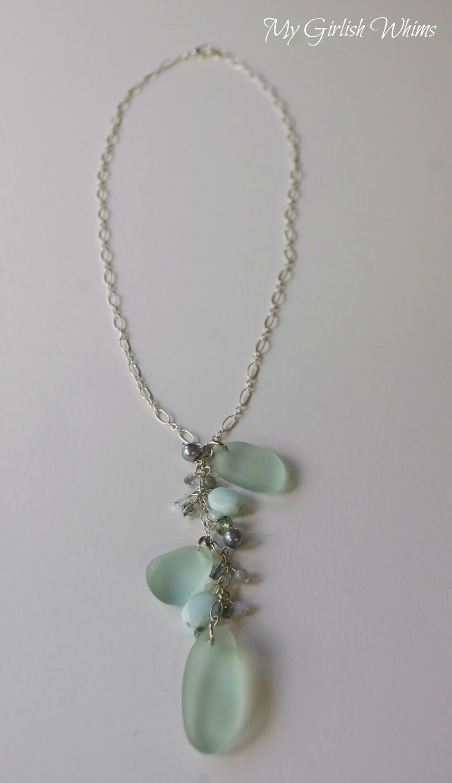 Diy sea glass necklace my girlish whims if you are inspired by the ocean or just need some beautiful cool blue jewelry hues in your life here is a step by step tutorial for how you can make your mozeypictures Images