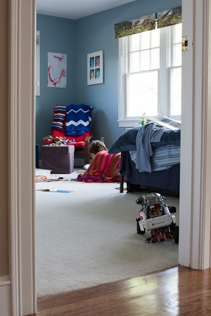 boy reading on the floor of his bedroom