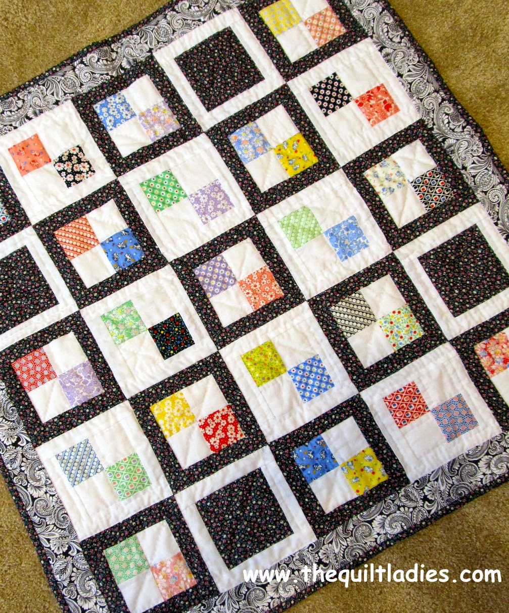 finished 4-patch quilt for baby or lap quilt