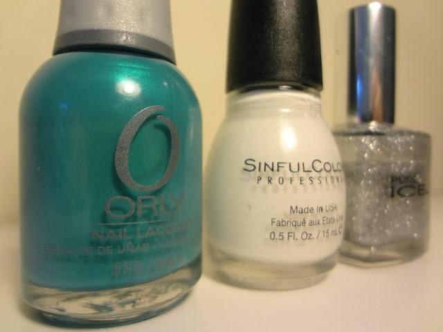 Turquoise nail polish, white nail polish, silver nail polish