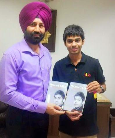 Dr. Sukhchain Singh Gill, IPS, SSP Chandigarh releasing book Hacking TALK with Trishneet Arora.