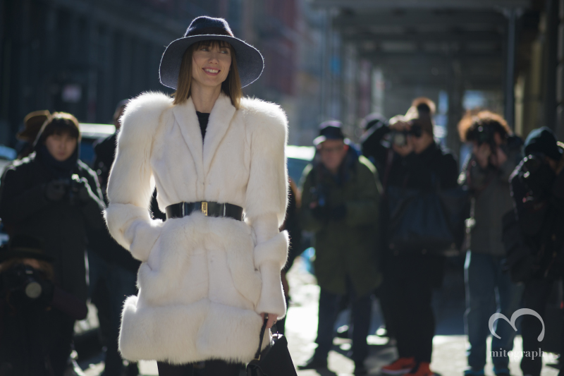 Stylist Anya Ziourova is taken photos by Street Style photographers during New York Fashion Week NYFW