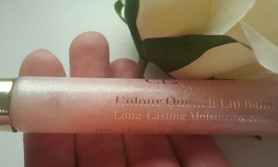 Clarins-Colour-Quench-Lip-Balm-with-a-rose-in-my-hand-at-my-home