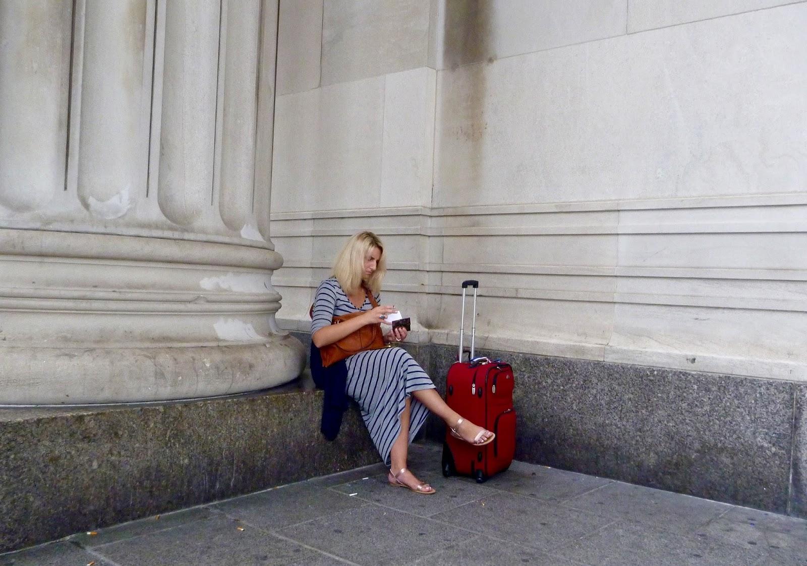 seated woman traveler smoking