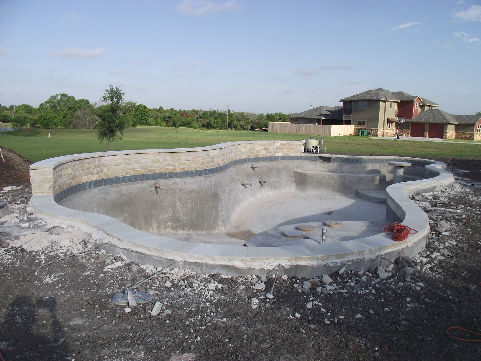 Freeform pool in texas started 3 27 12 finished - Fibreglass swimming pool bond beam ...