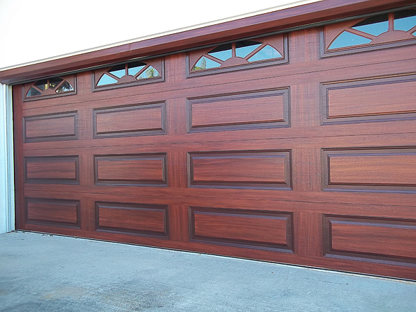 Orange base coat color on garage door everything i for How to paint a garage door to look like wood