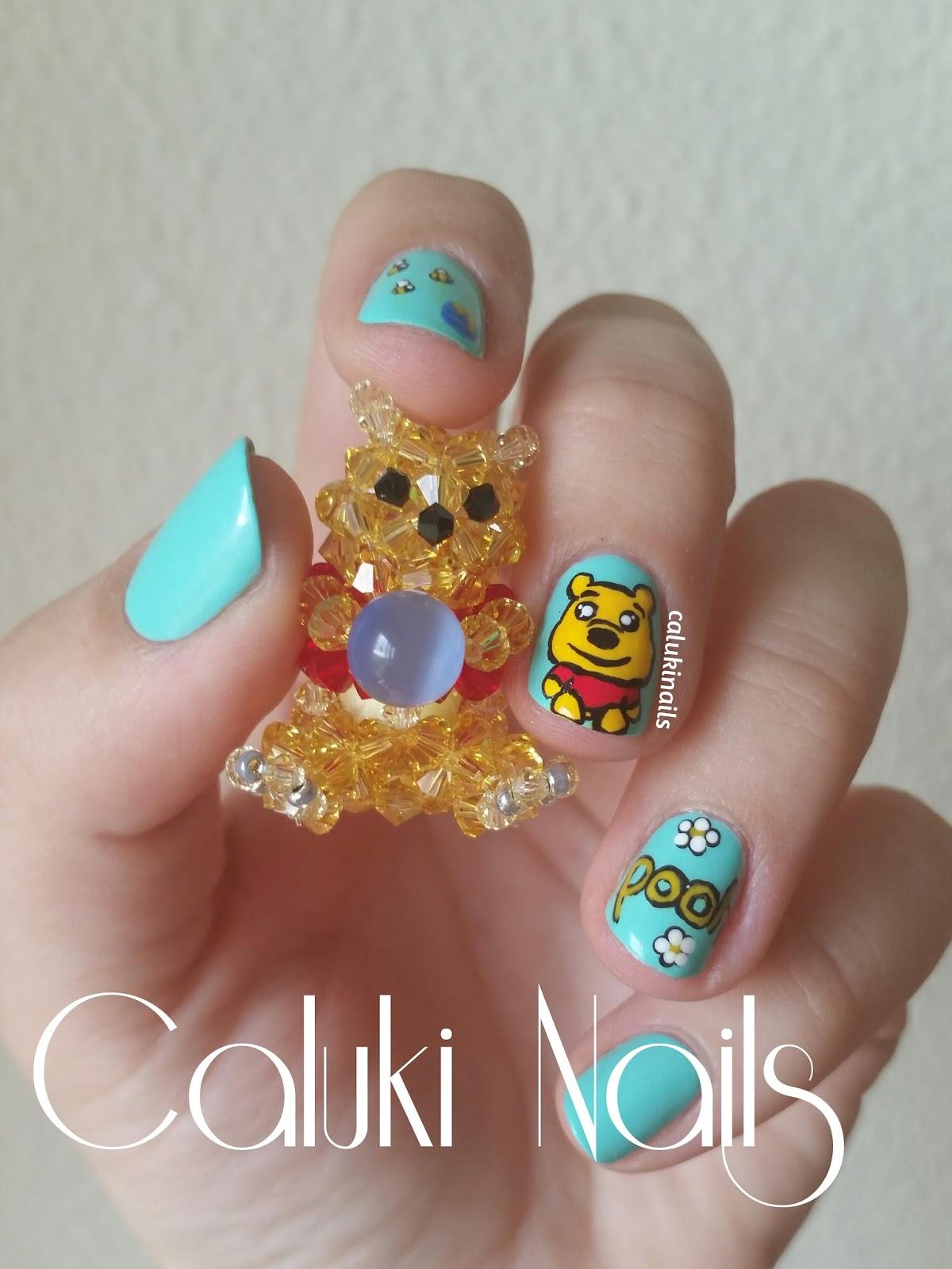 son las manualidades, y aquí quiero que veáis uno de los muñecos que he hecho con cristales de Swarovski con la forma de Winnie the Pooh.