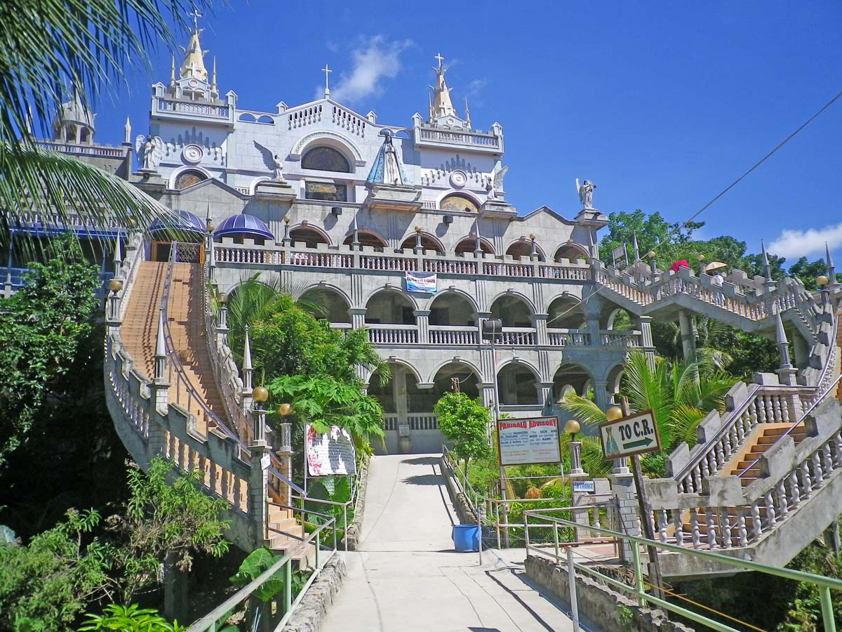 simala church About simala shrine the monastery of the holy eucharist, popularly known as the simala shrine or simala church is located in marian hills, lindogon, simala, sibonga.