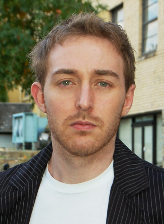 headshot of a white male actor in daylight