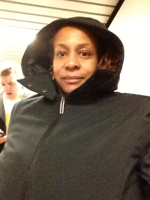 Flight Attendant Janice wearing a Penny Coat from Scottevest.