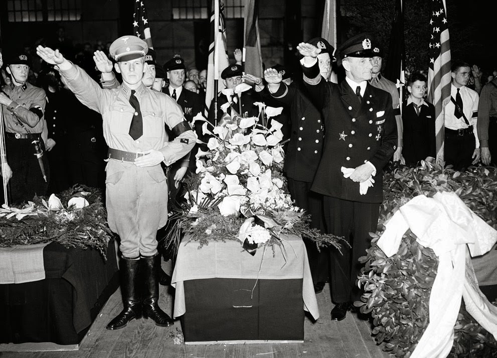 German soldiers give the salute as they stand beside the casket of Capt. Ernest A. Lehmann, former commander of the zeppelin Hindenburg.