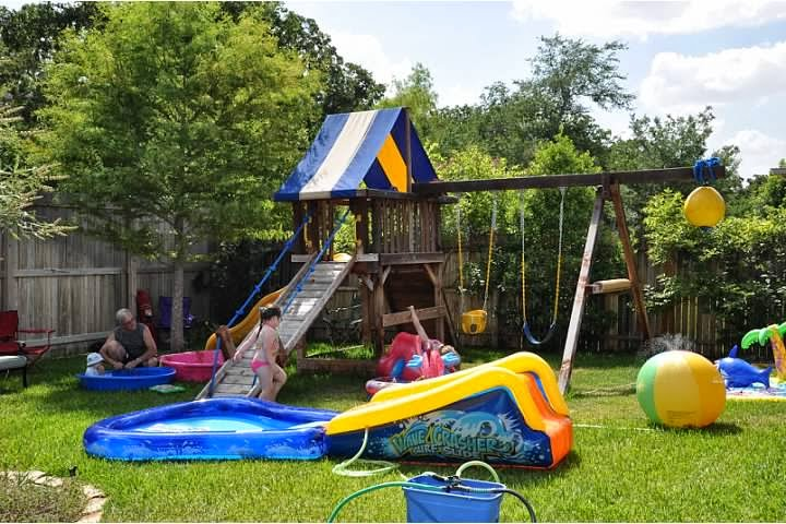 Party Was In The Backyard A Multitude Of Pools And Water Toys Every Shape Size Were Set Up Kids Adults Ready To Have Splish