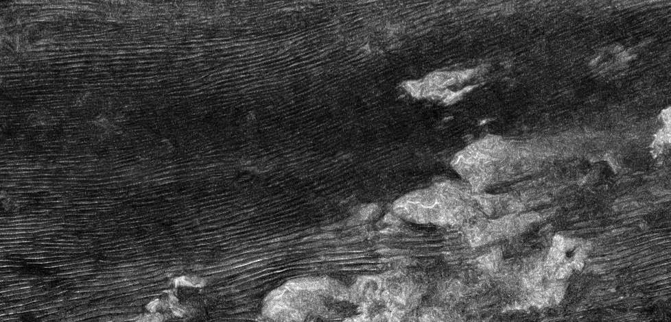"A NASA image of sand dunes near the equator on Titan's surface, shot by the Cassini-Huygens spacecraft and""denoised"" by Antoine Lucas. UW astronomer Benjamin Charnay and co-authors, including Lucas, may have solved the mystery of Titan's sand dunes and surface winds aiming in opposite directions. Credit: NASA/JPL/Space Science Institute"