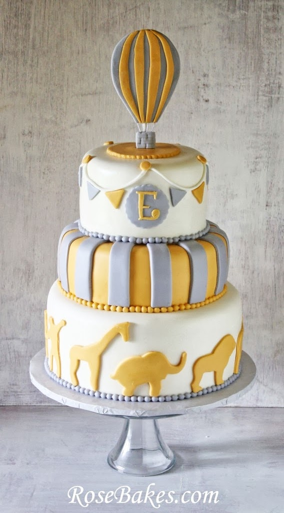 Gray and yellow cake with hot air balloon and animals