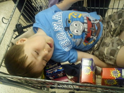 Boy Asleep in Trolley