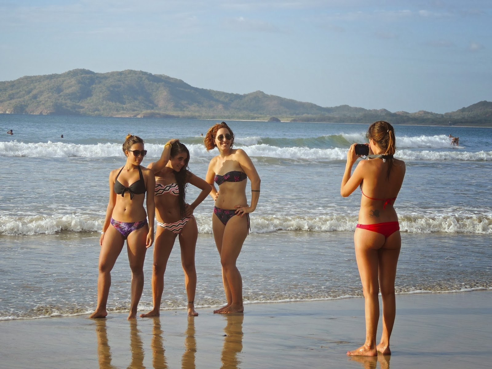 Young Women Taking A Group Photo On The Beach